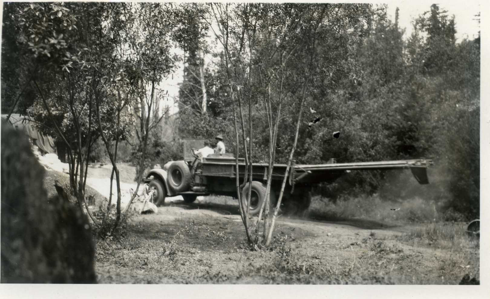 1931 June, County Truck Hauling pipe to connect up water system with swimming pool